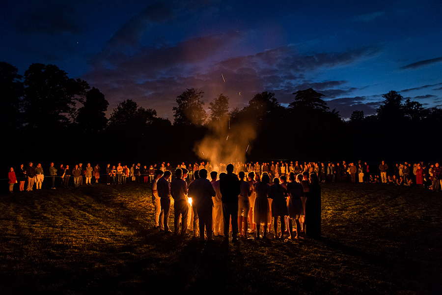 Members of Class 12 sing after lighting the St John's Fire at the Midsummer Festival - Michael Hall School